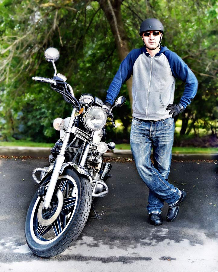 man beside motorcycle