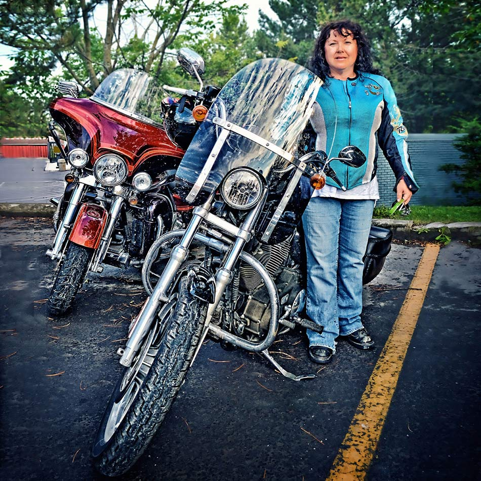 woman beside motorcycle