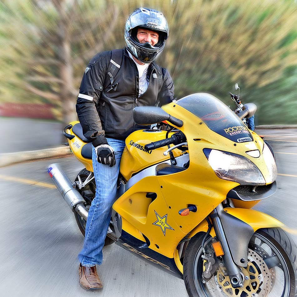 man on yellow motorcycle