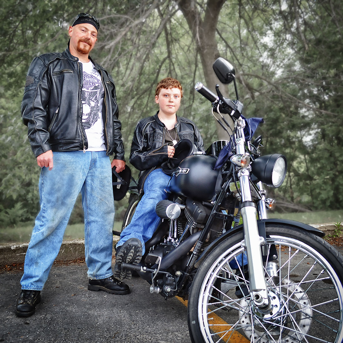 man with little brother on motorbike