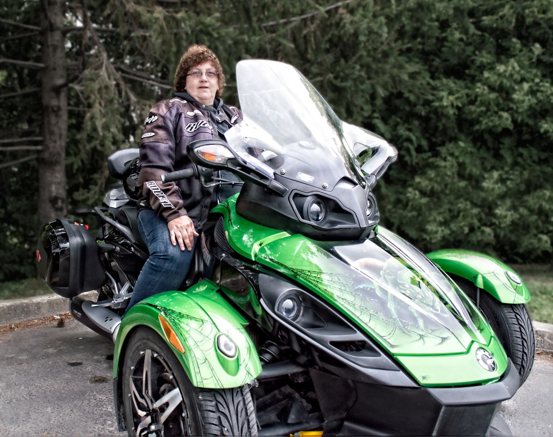 photo of woman on motorcycle